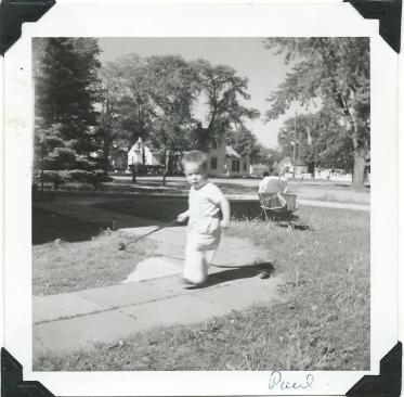 Paul running with golf club